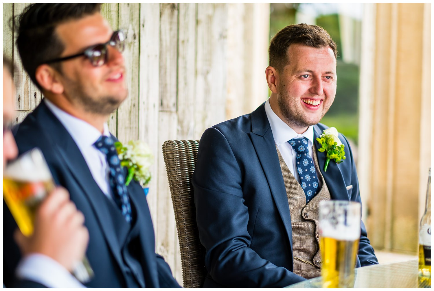 groom having a drink with the guys