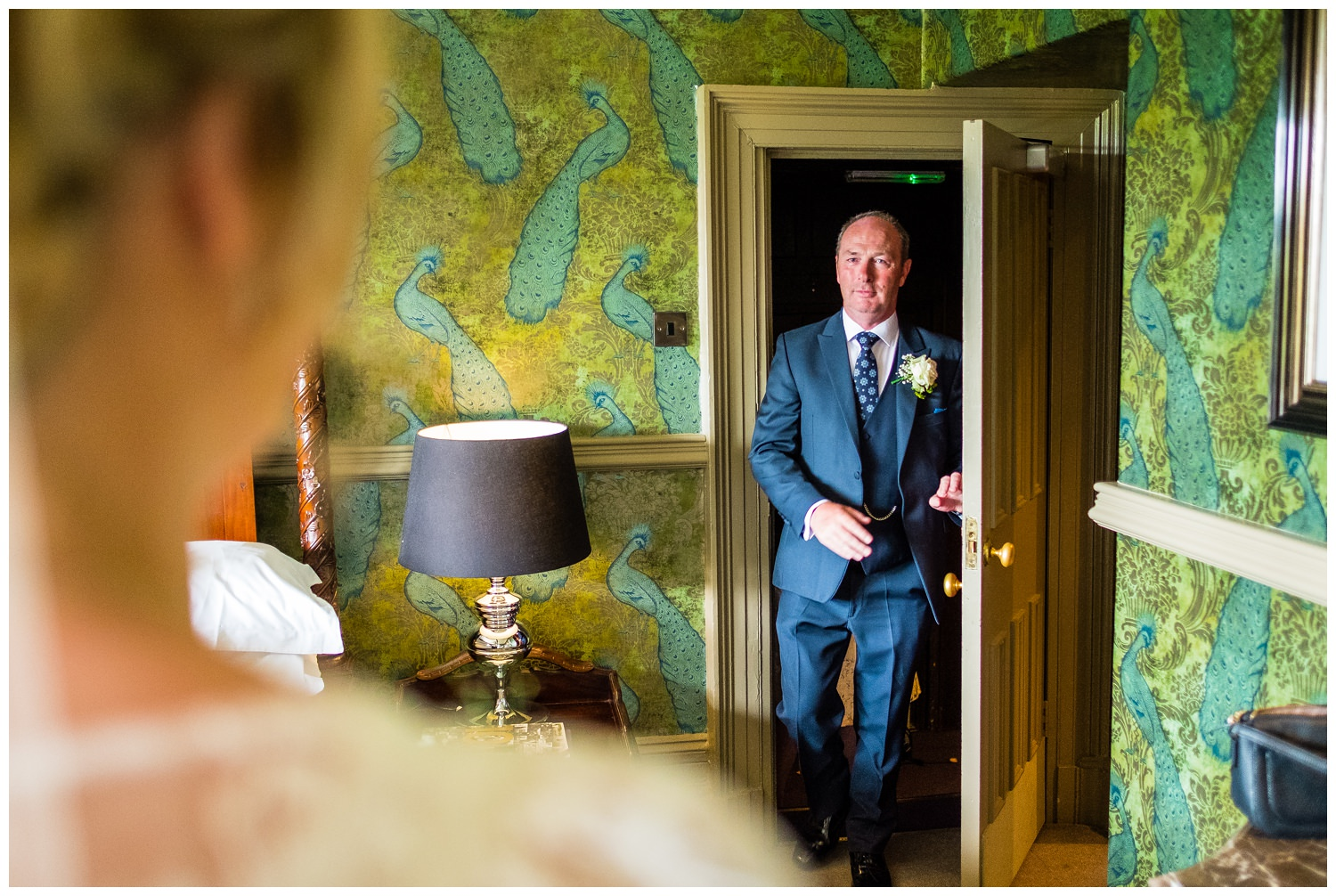 father of the bride sees bride for the first time in her dress