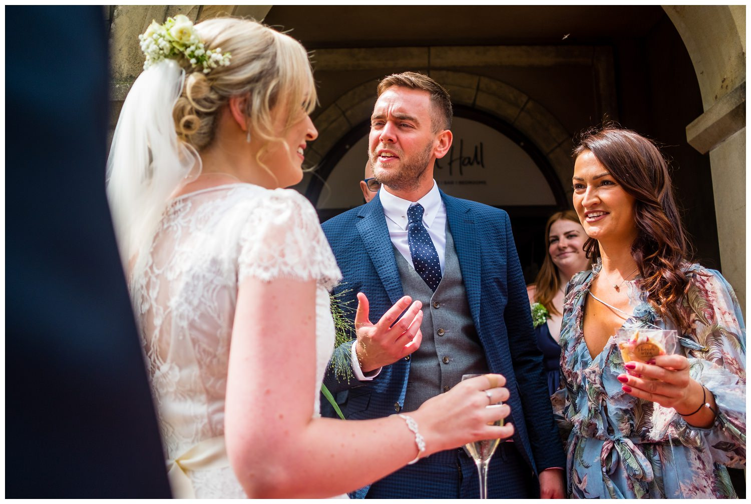 guests greeting newly weds after wedding ceremony