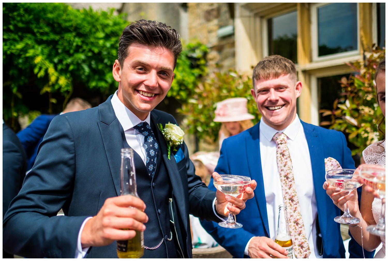 groomsmen with 2 drinks