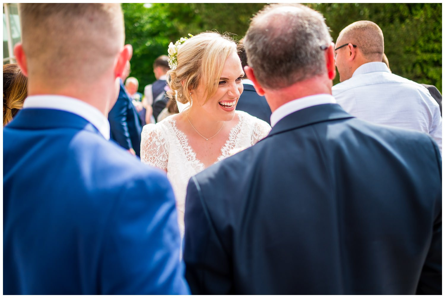 bride laughing with her family