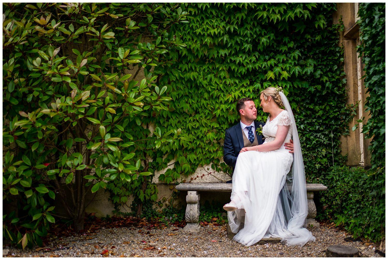 bride sat on grooms knee