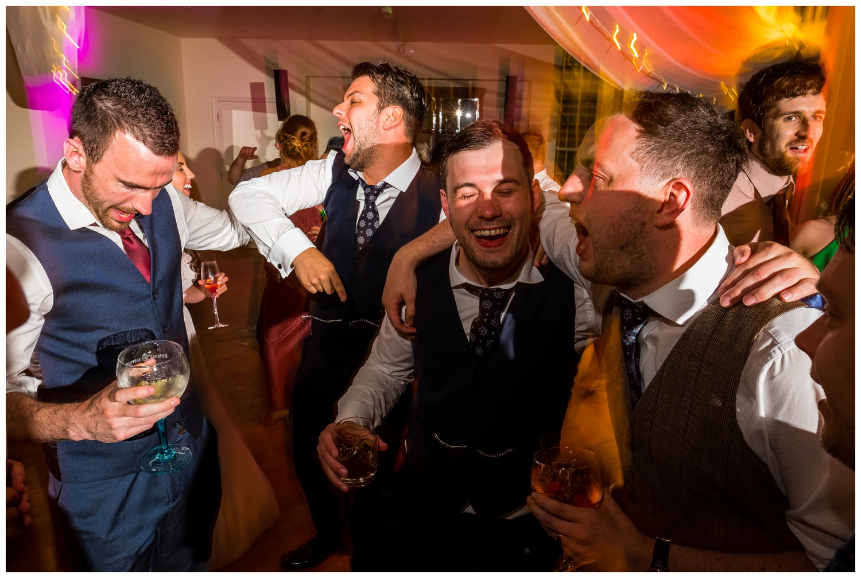 groom and guys dancing