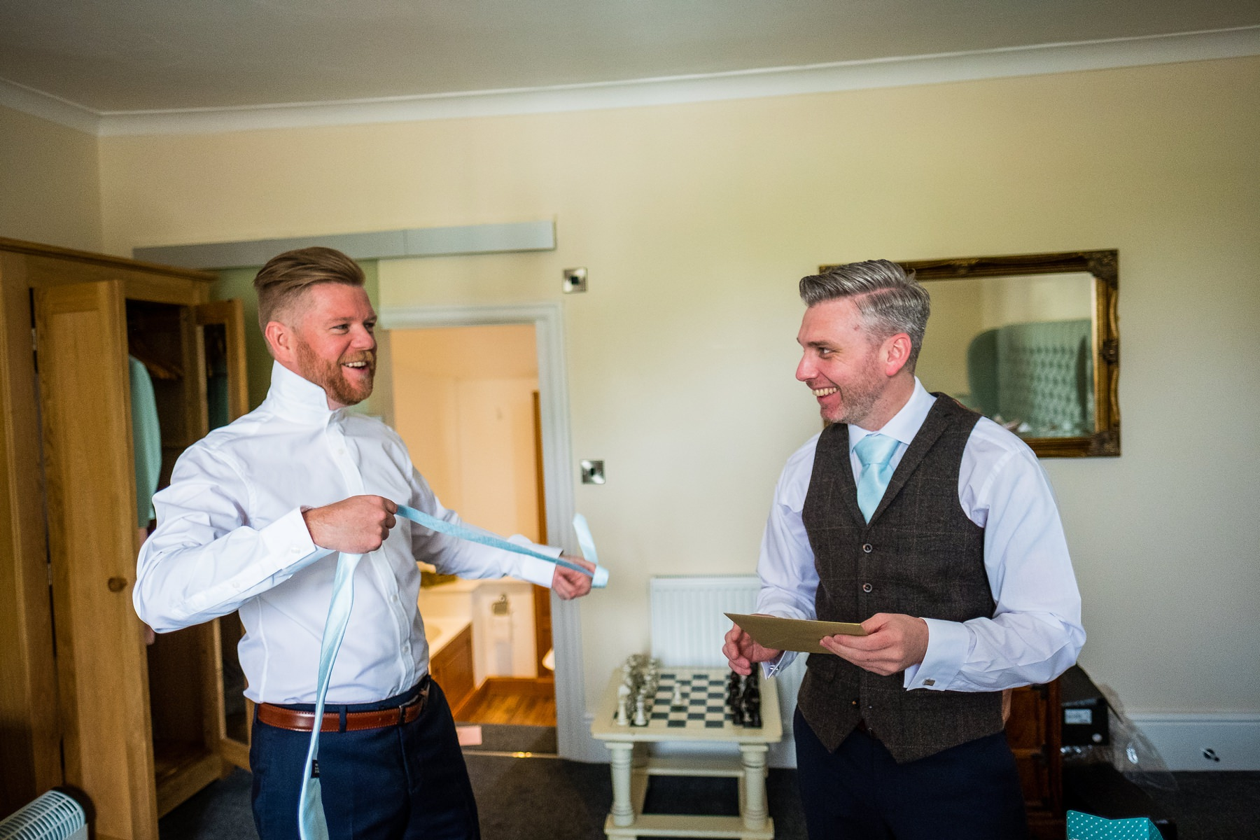 groom and best man getting ready