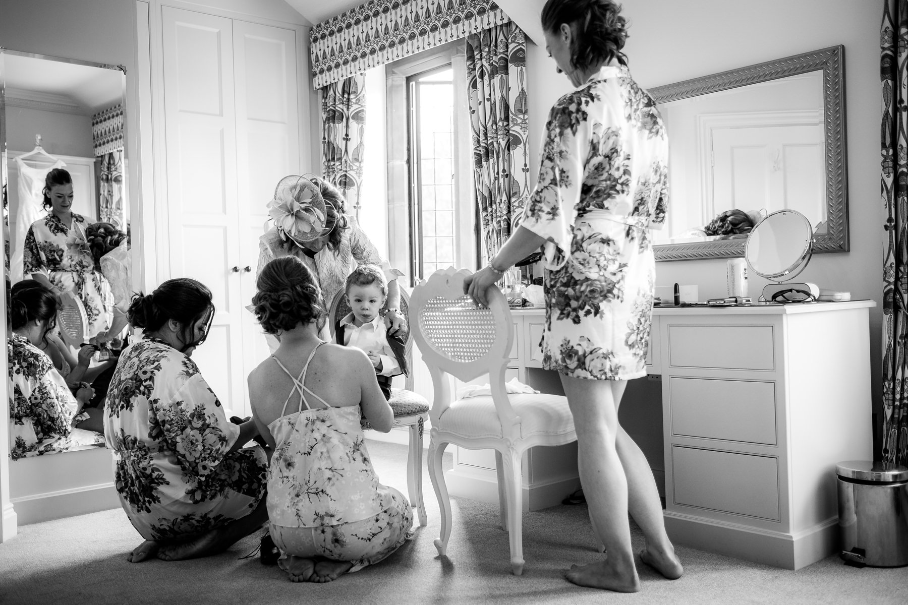 bridesmaids getting page boy ready