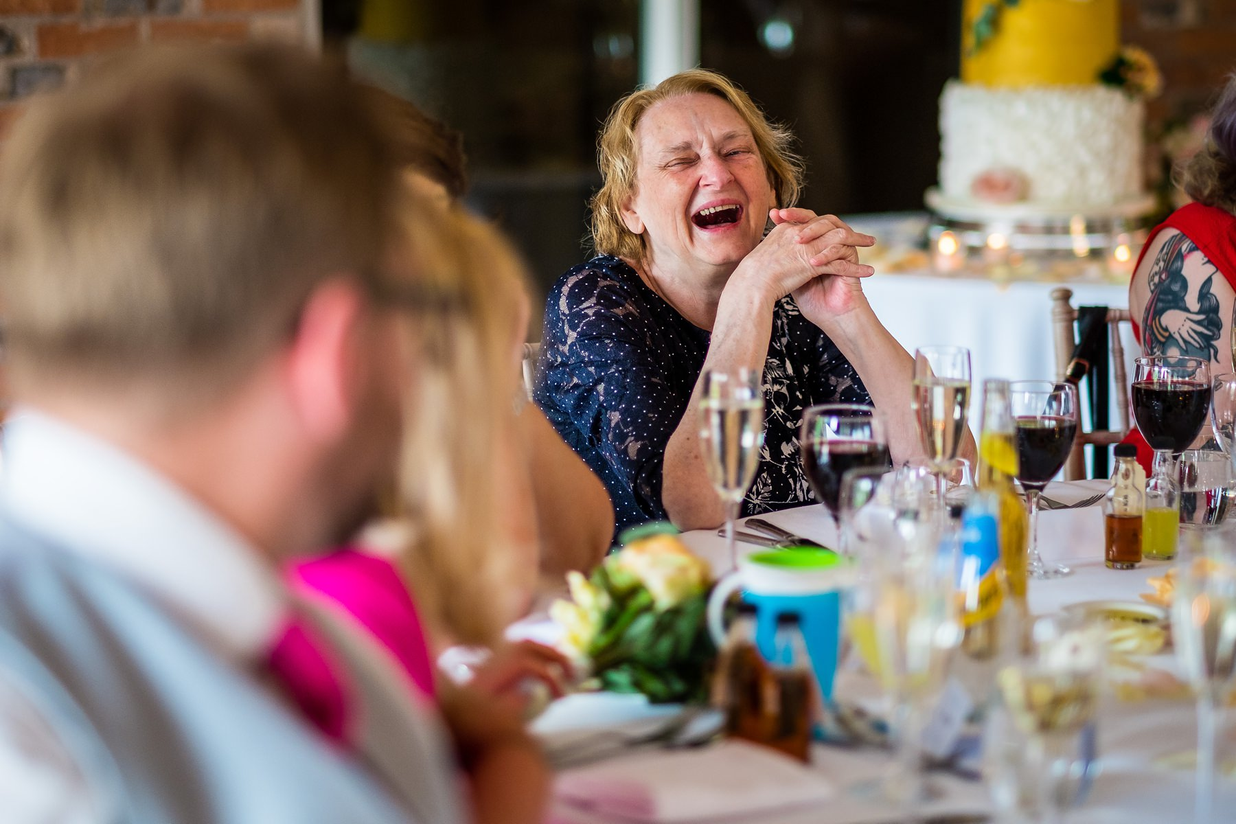guest laughing during speeches