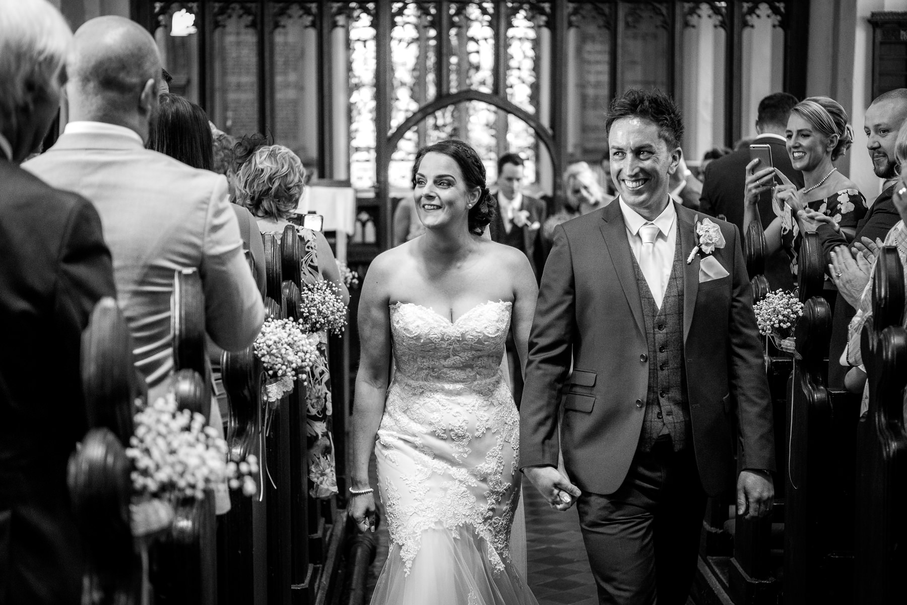 bride and groom leaving the church, lancashire