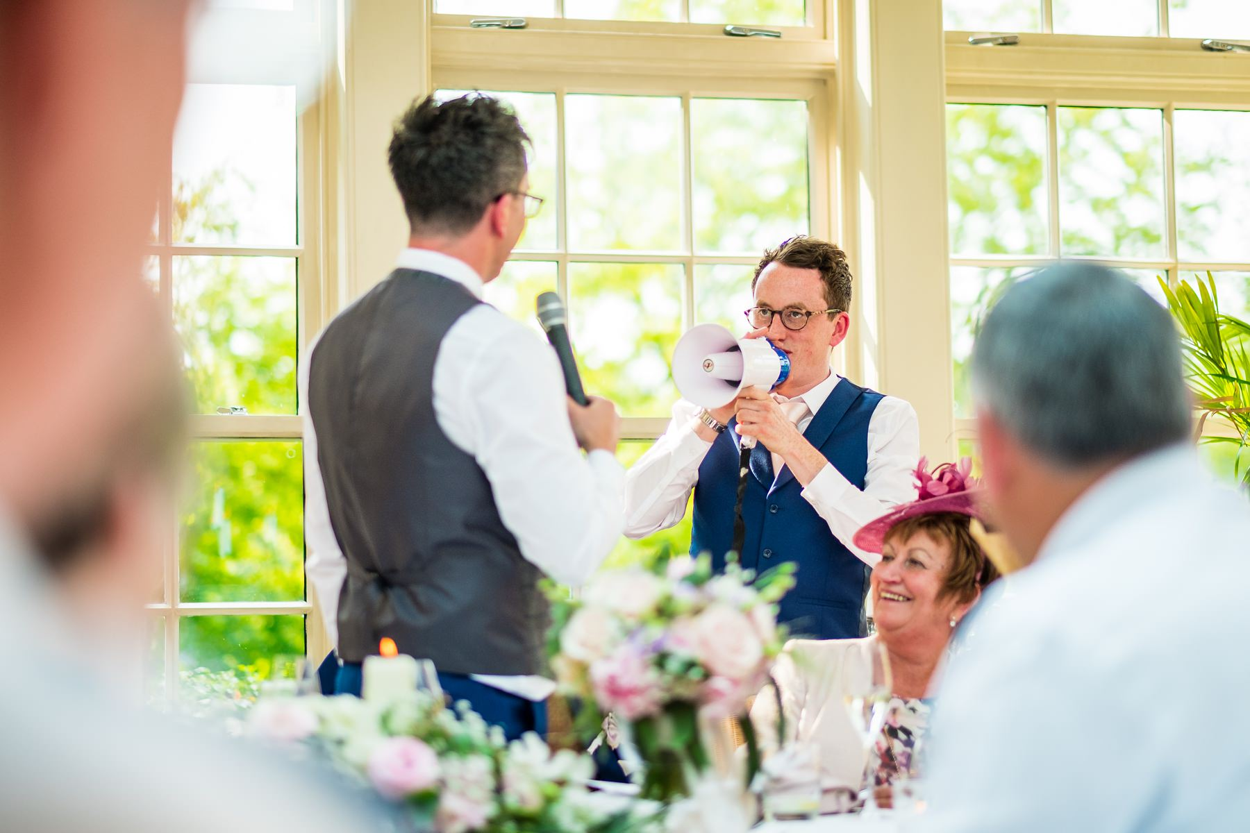 bother of the groom standing during speeches