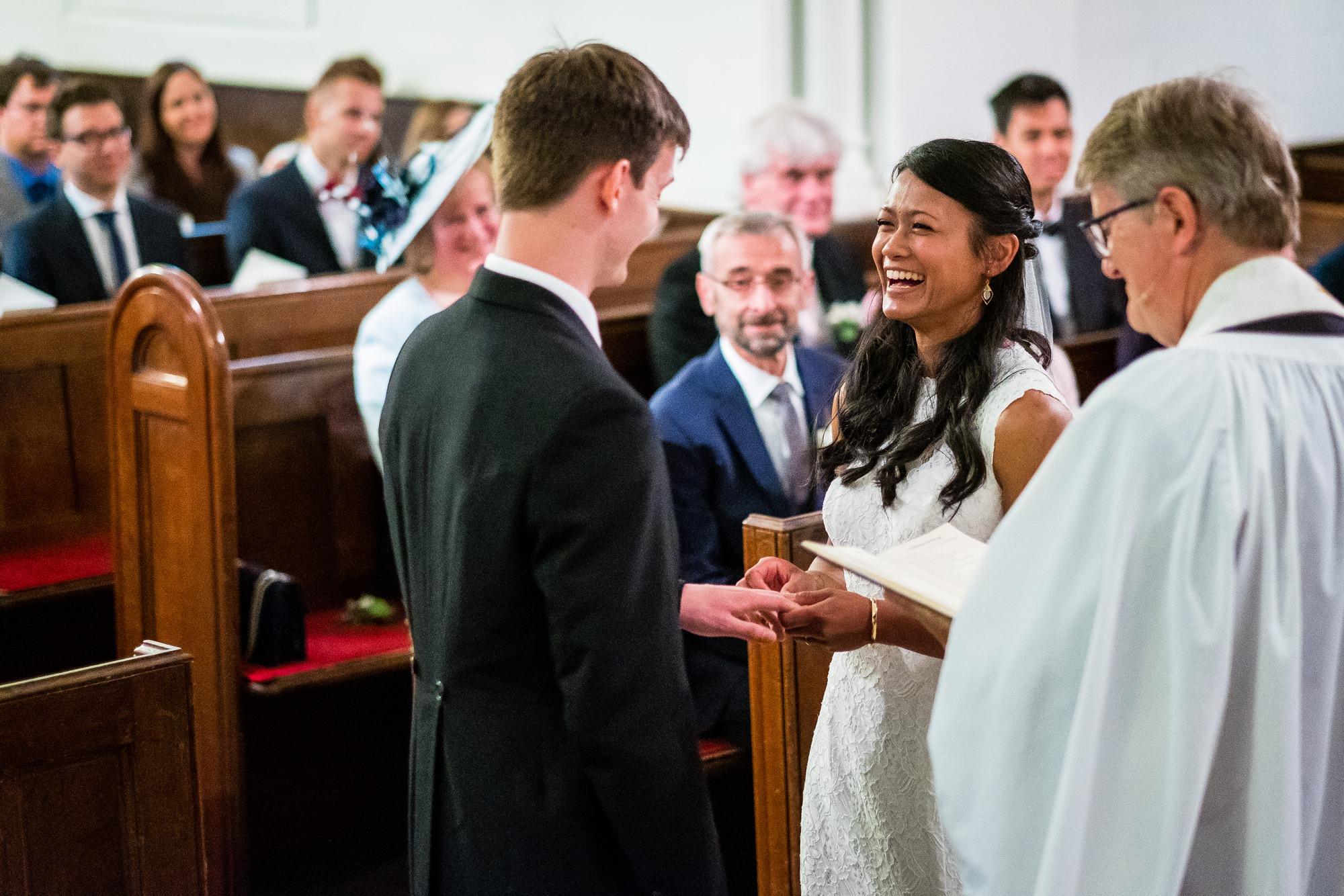 groom exchanging rings