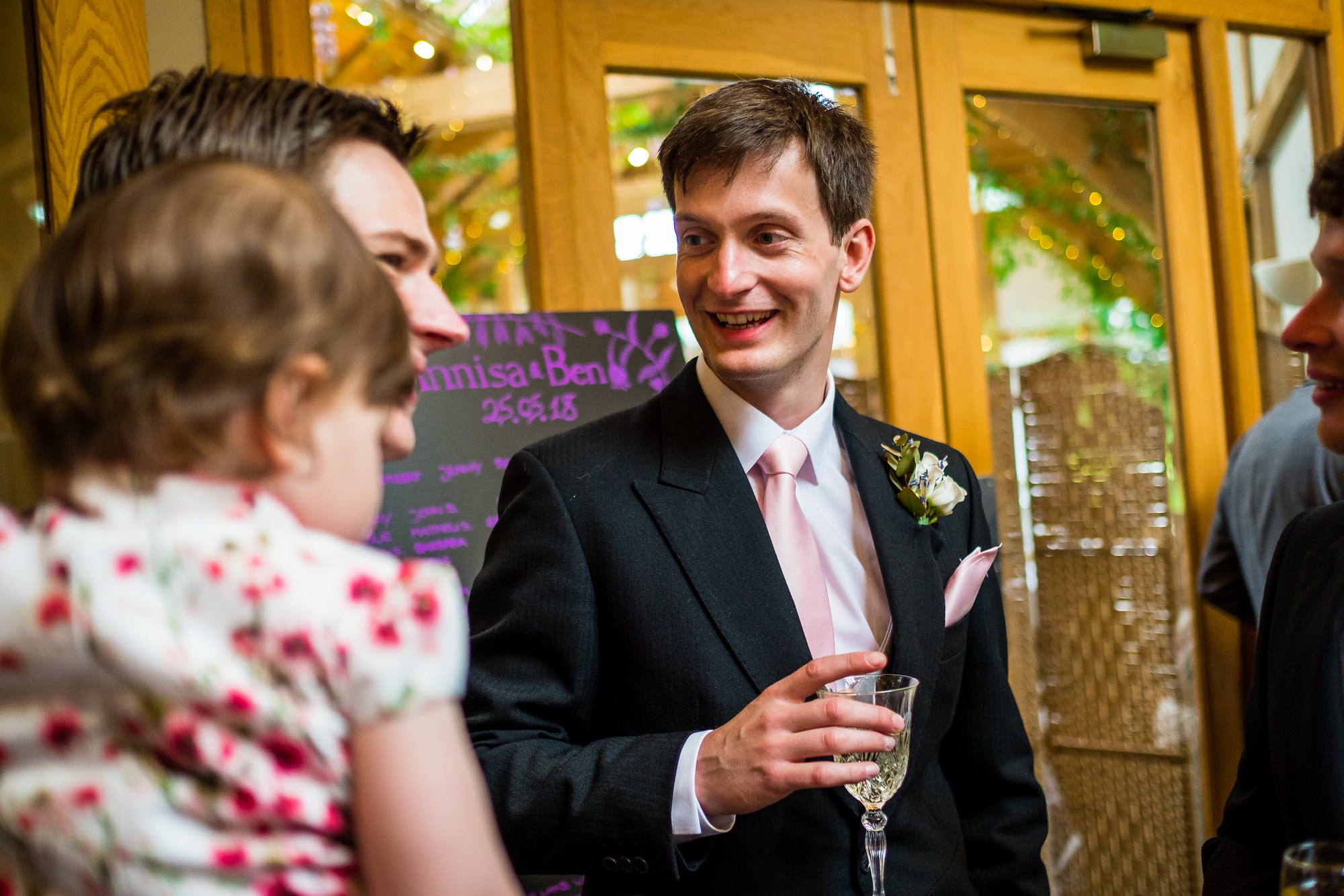 groom chatting with guests