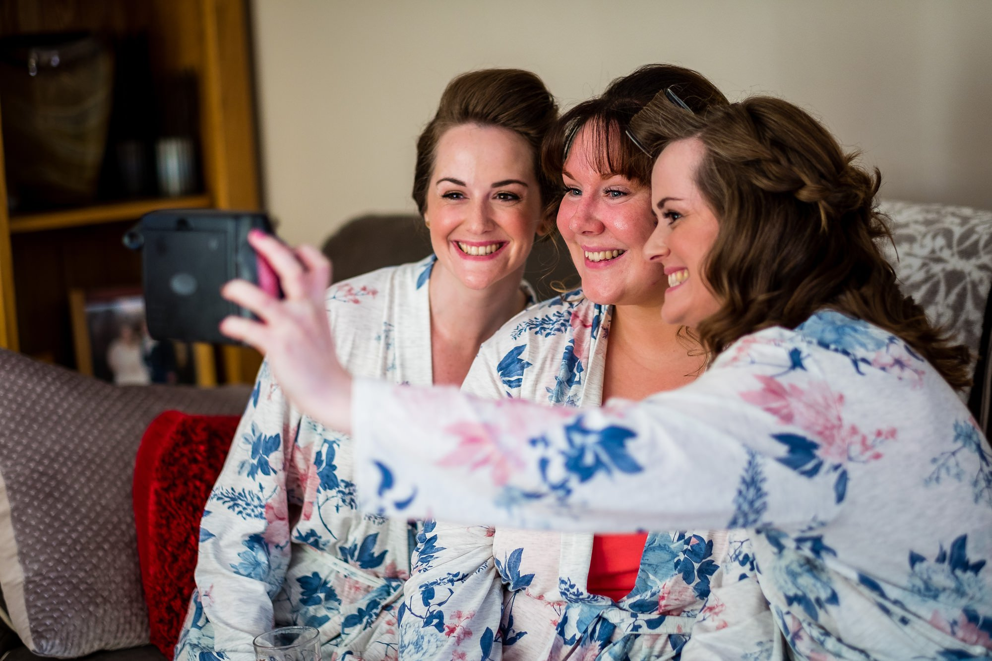 bride and bridesmaids doing a selfie
