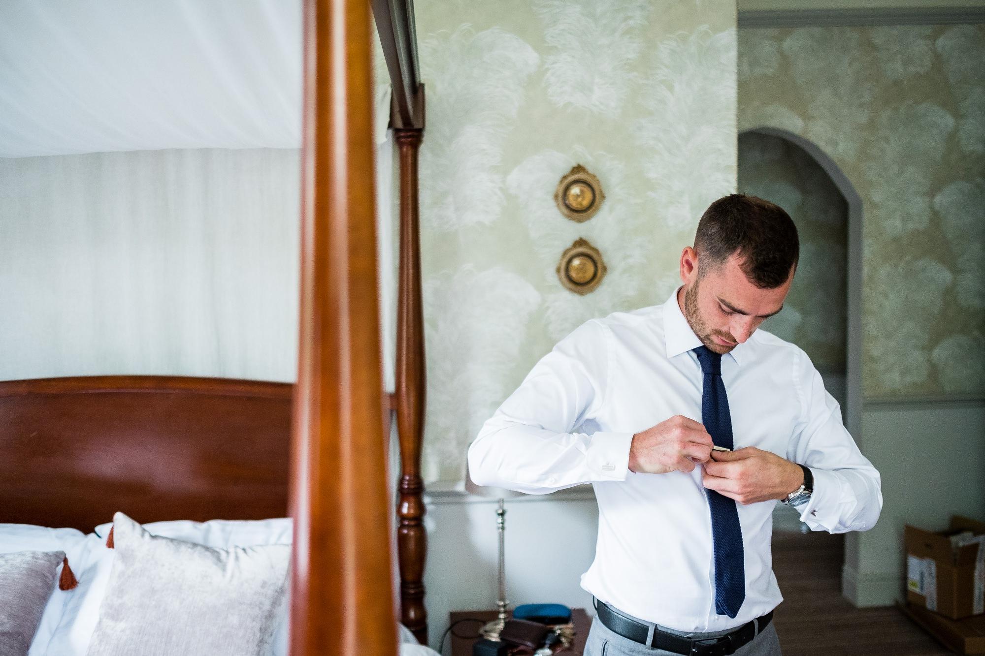 fastening up wedding suit