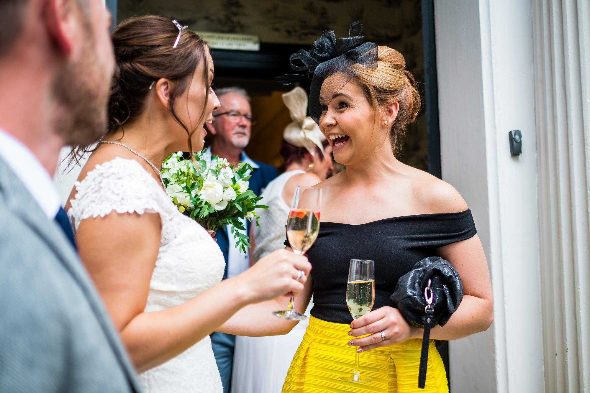 guest smiling at bride