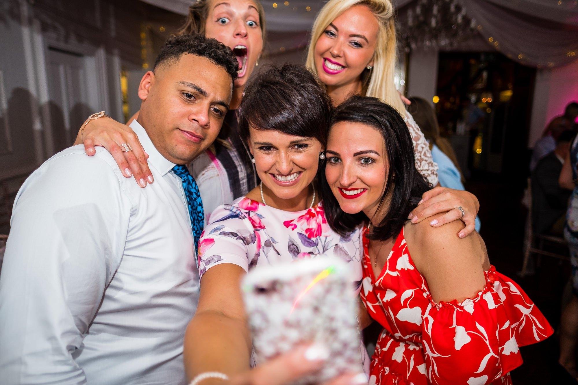 wedding guests doing selfies