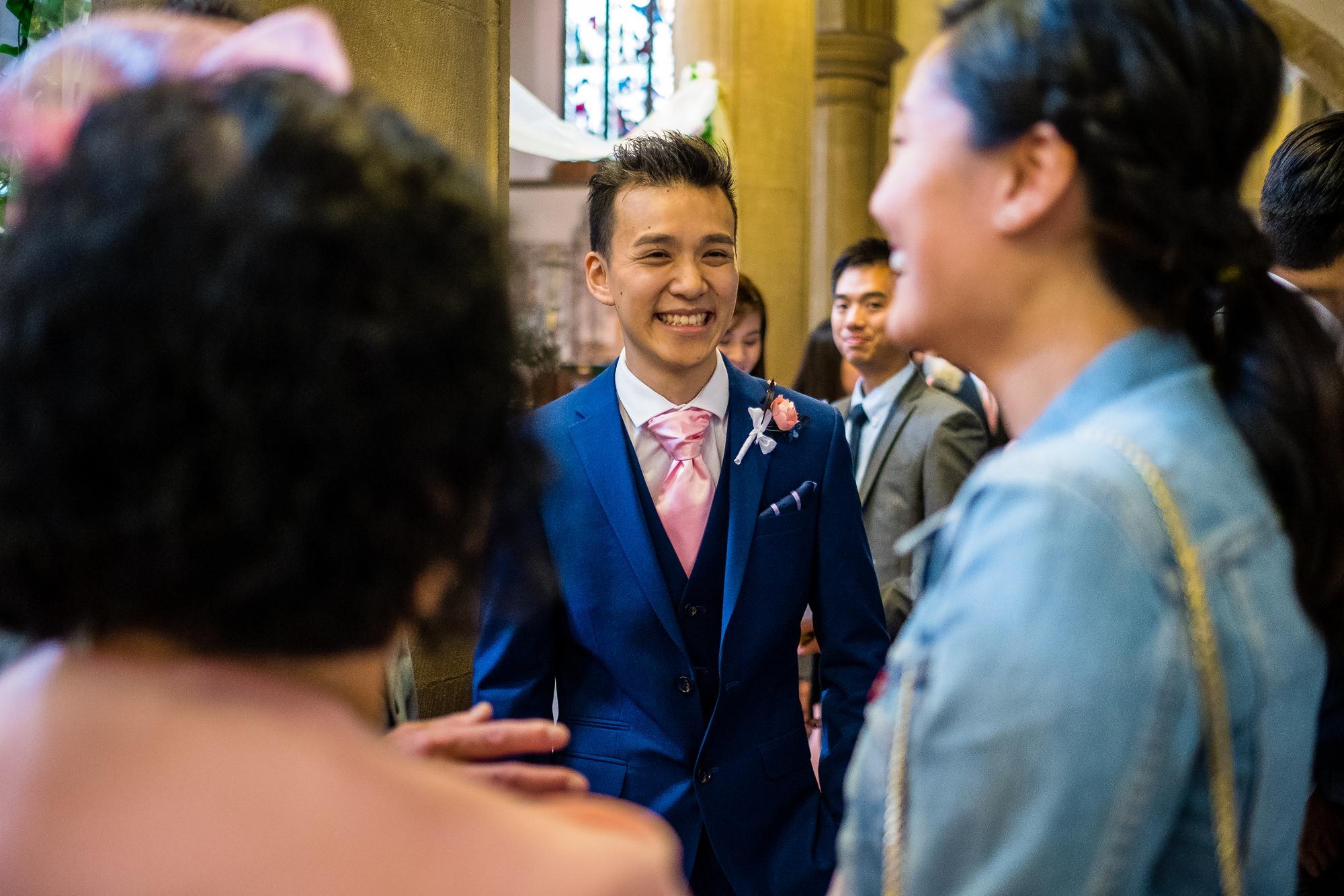 groom greeting guests at church