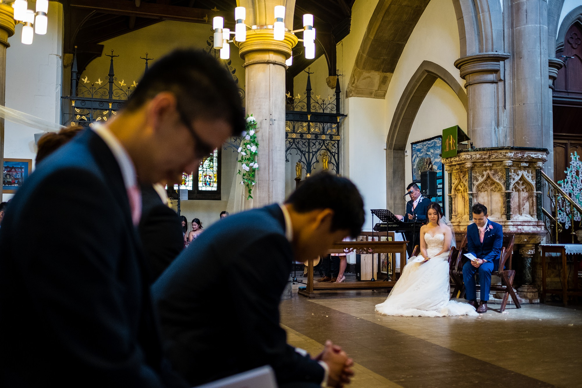 bride and groom during prays