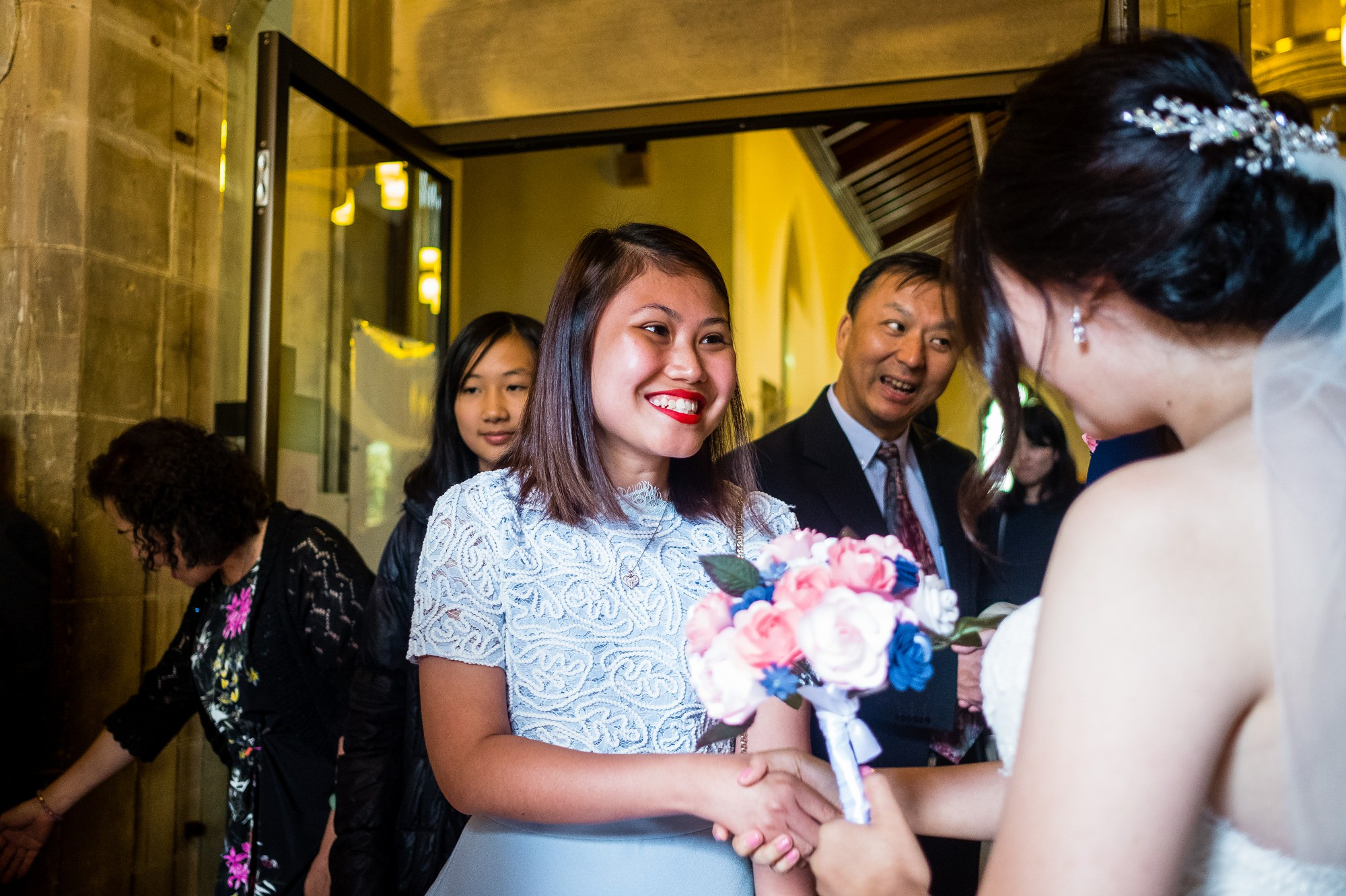 guest greeting bride and groom