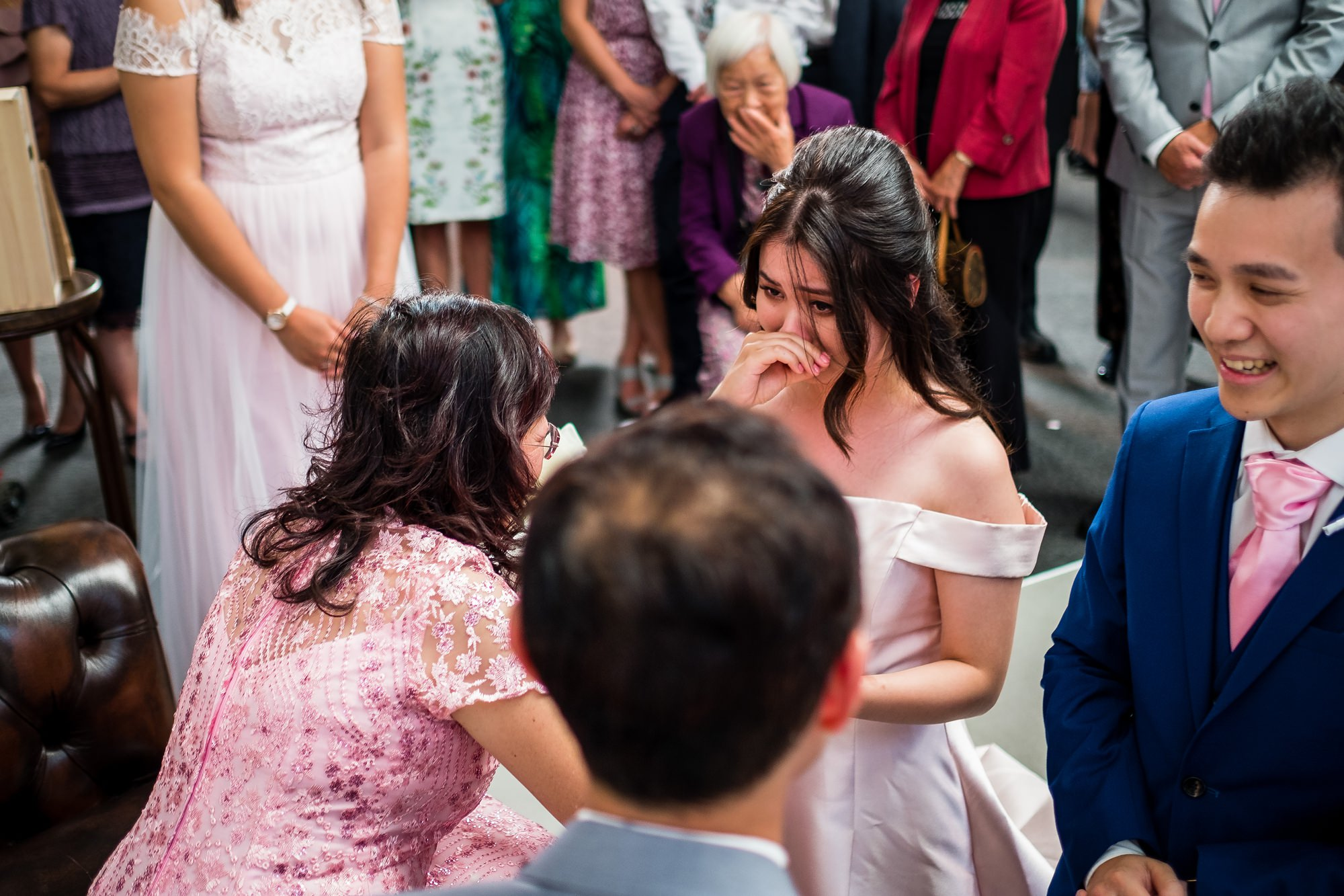 bride crying during tea serving ceremony