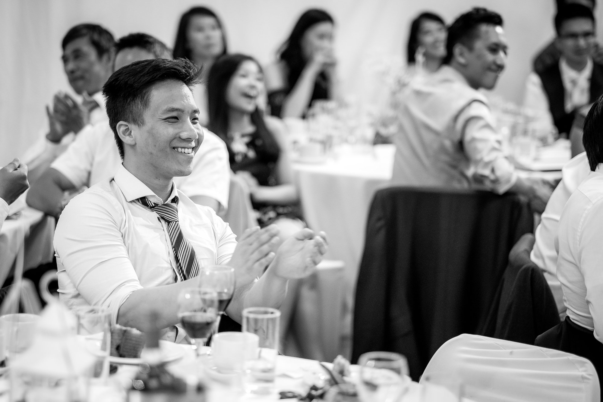 guests smiling during speeches