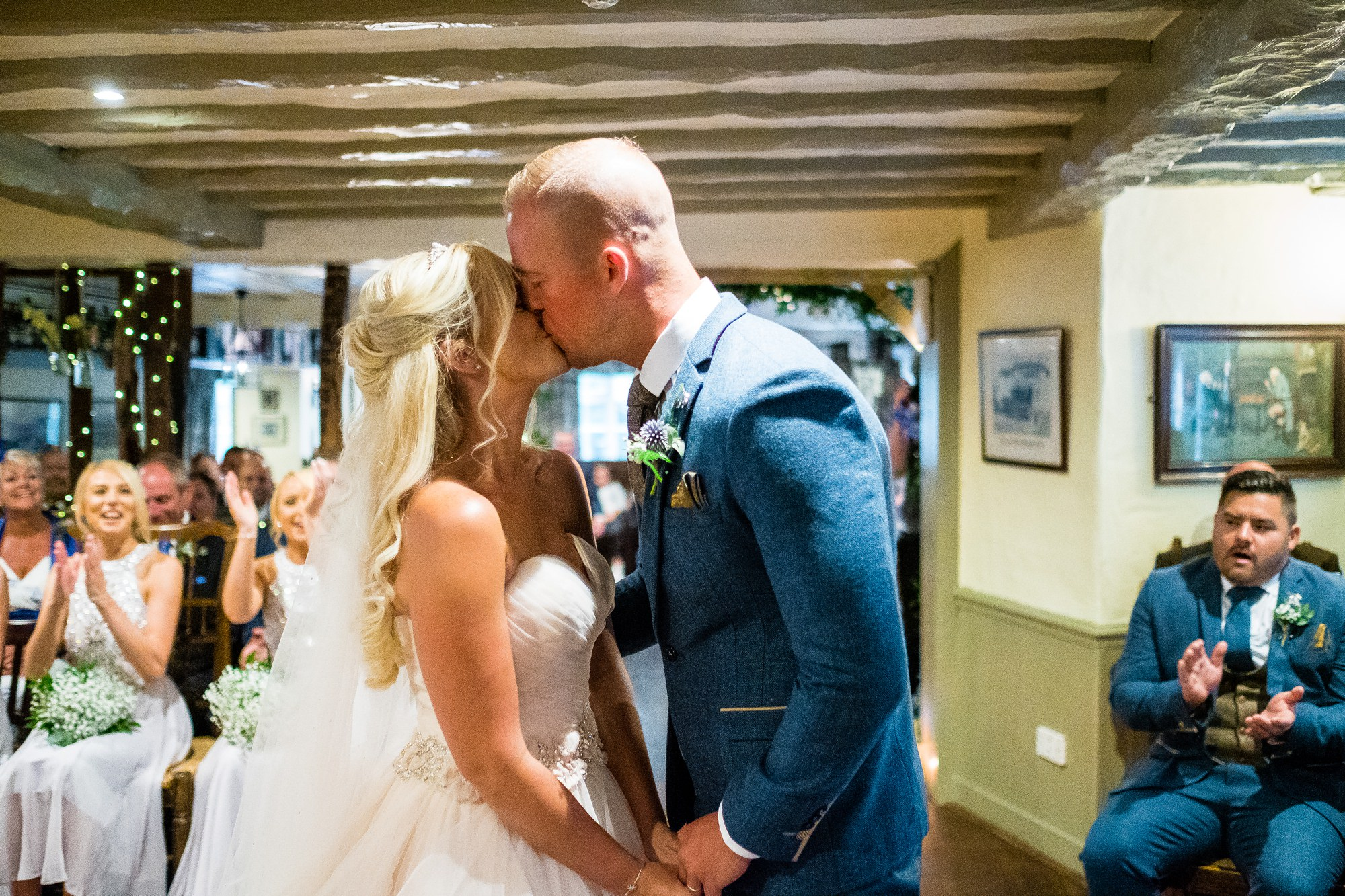bride and groom first kiss in Windermere
