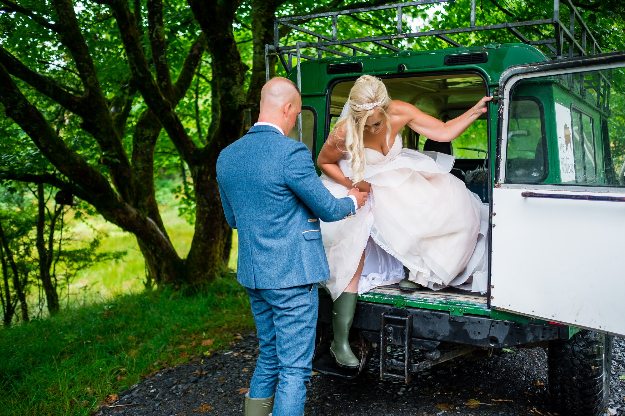 bride stepping out of land rover