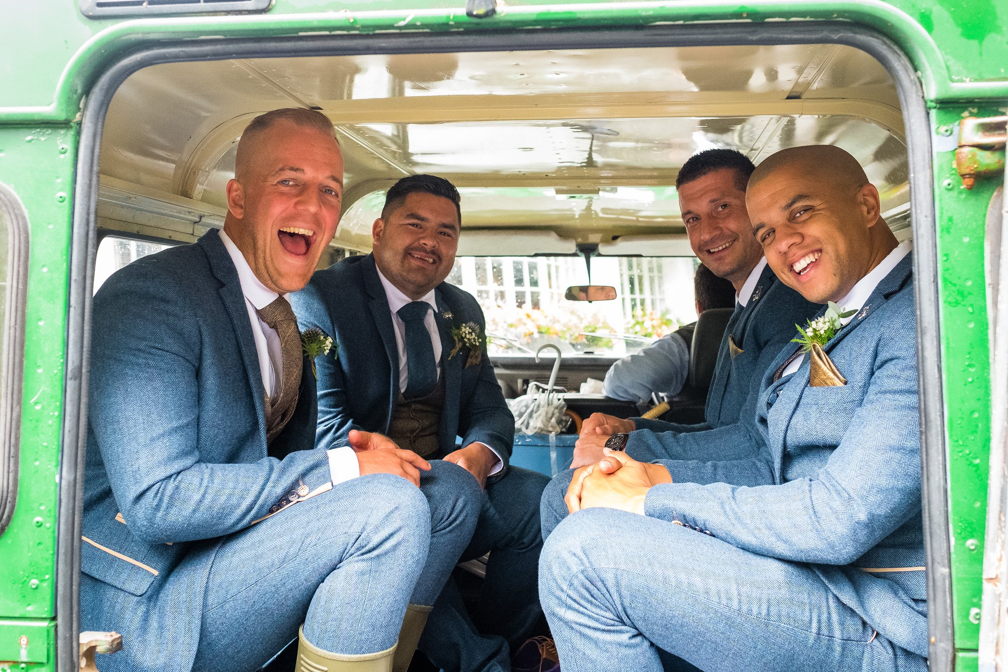 groomsmen in land rover