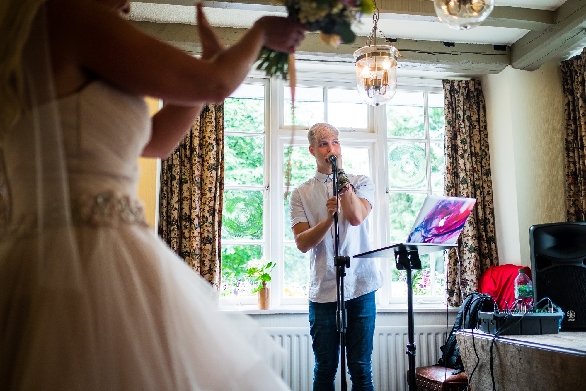 singer performing to bride