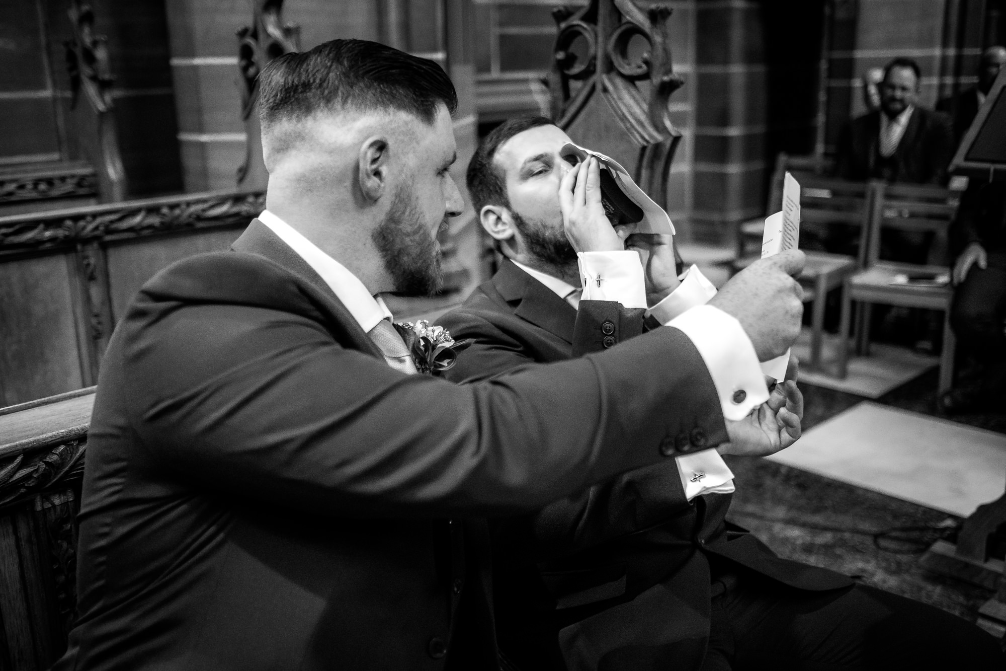 groom having a quick drink before the wedding ceremony
