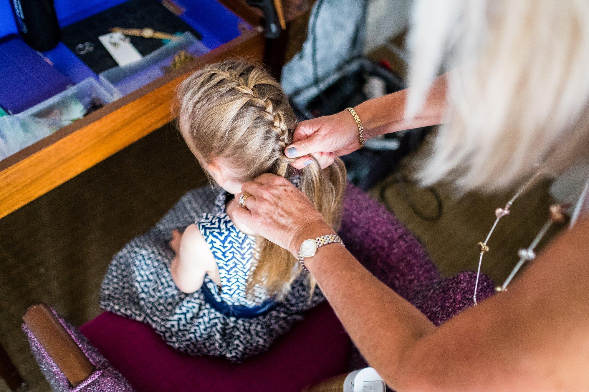 flower girl having her hair done