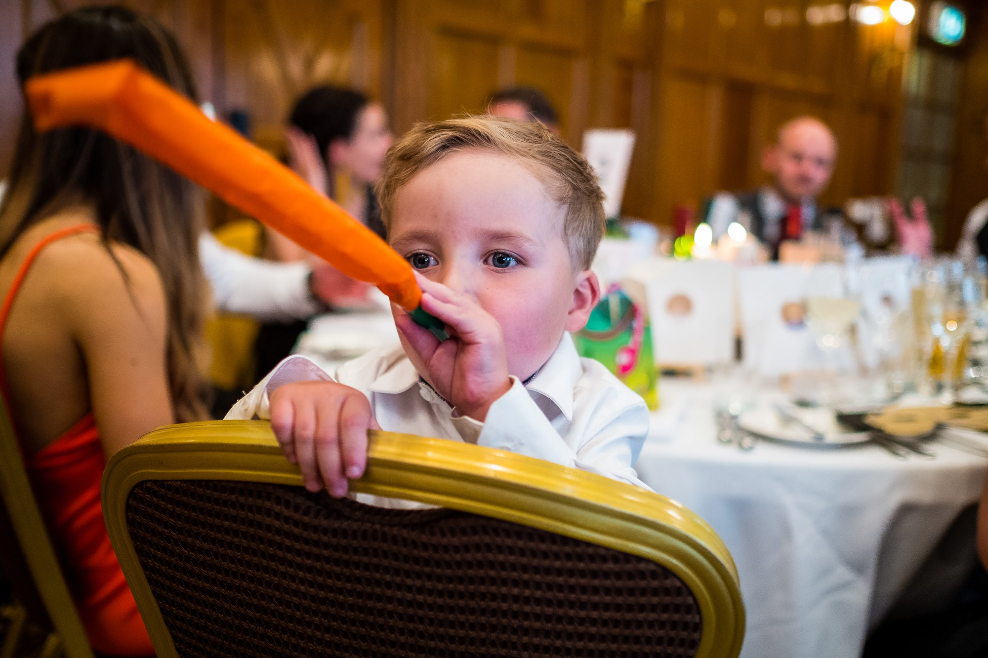 child with party blower