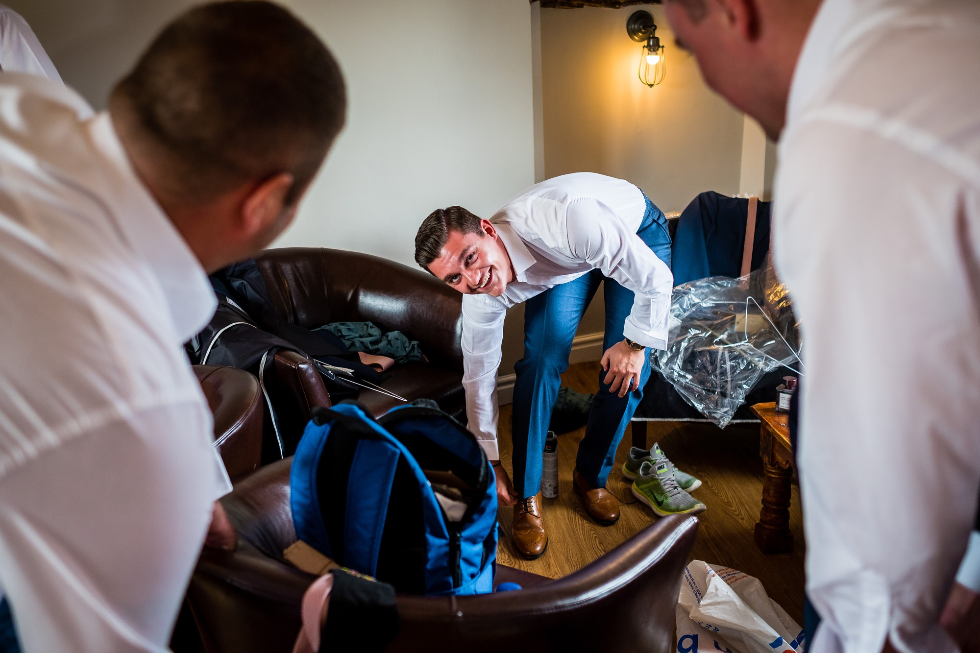 groomsmen putting on shoes