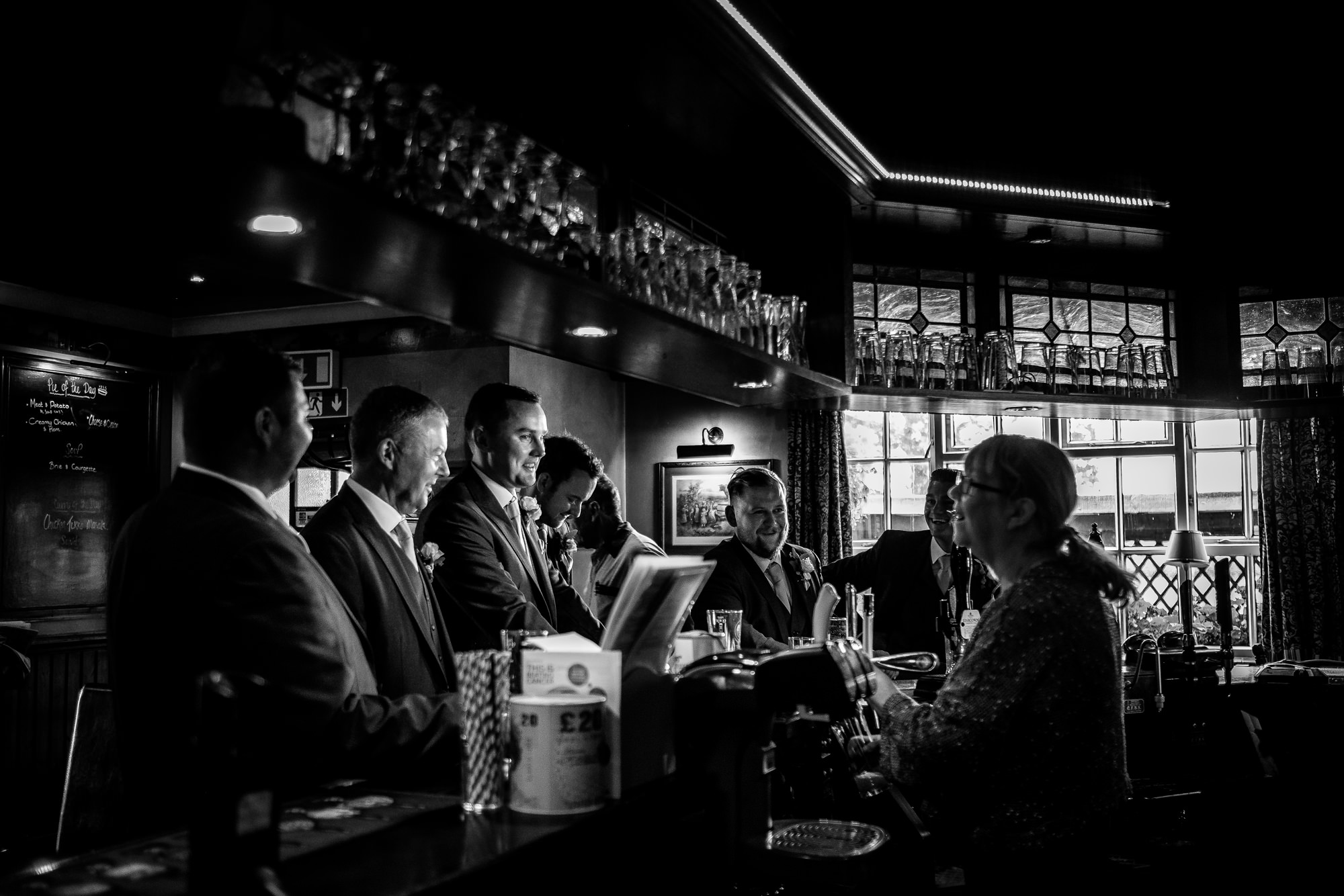 groom at the bar with friends