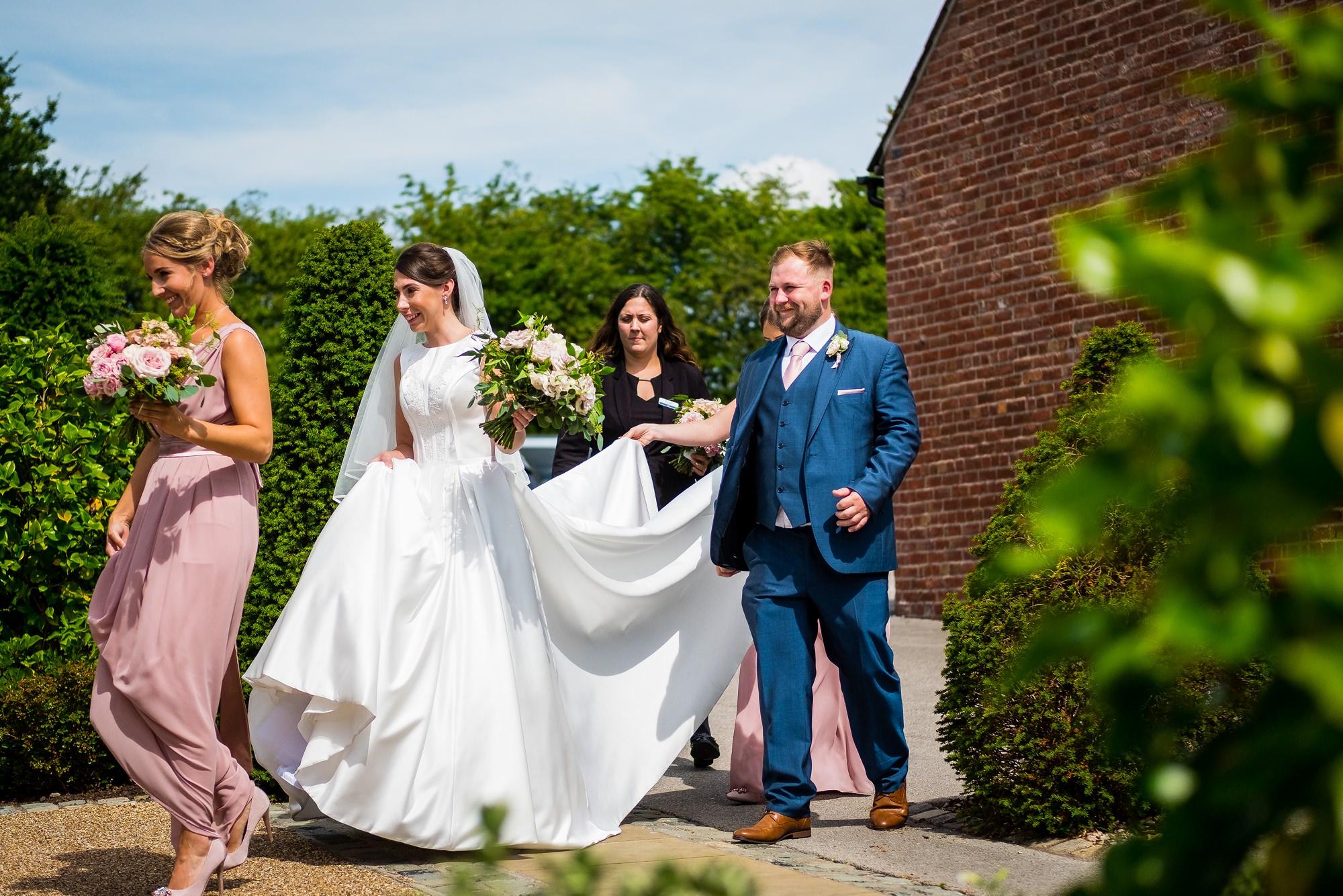 bride walking into sandhole oak barn