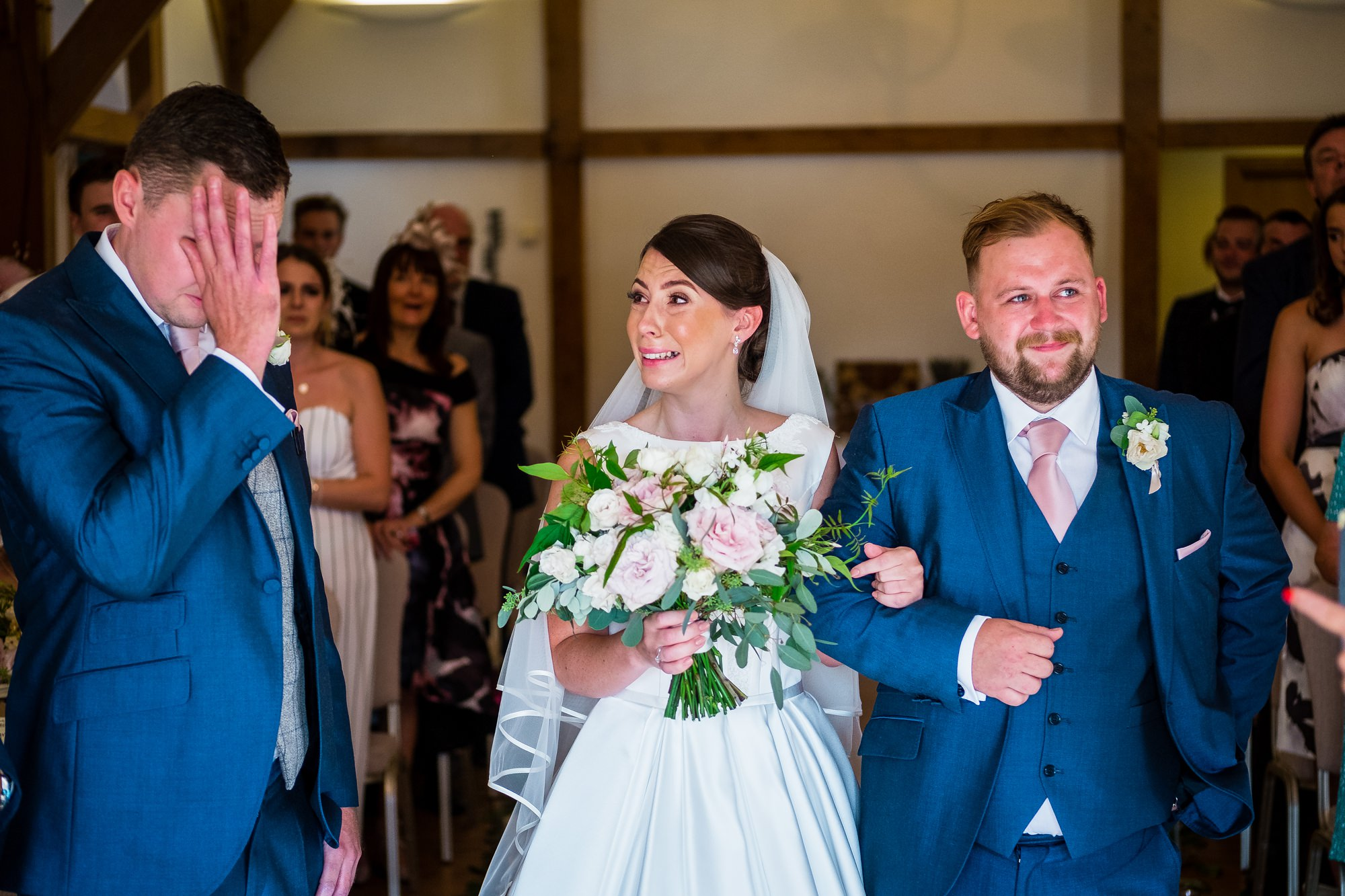 bride, groom and brother all crying