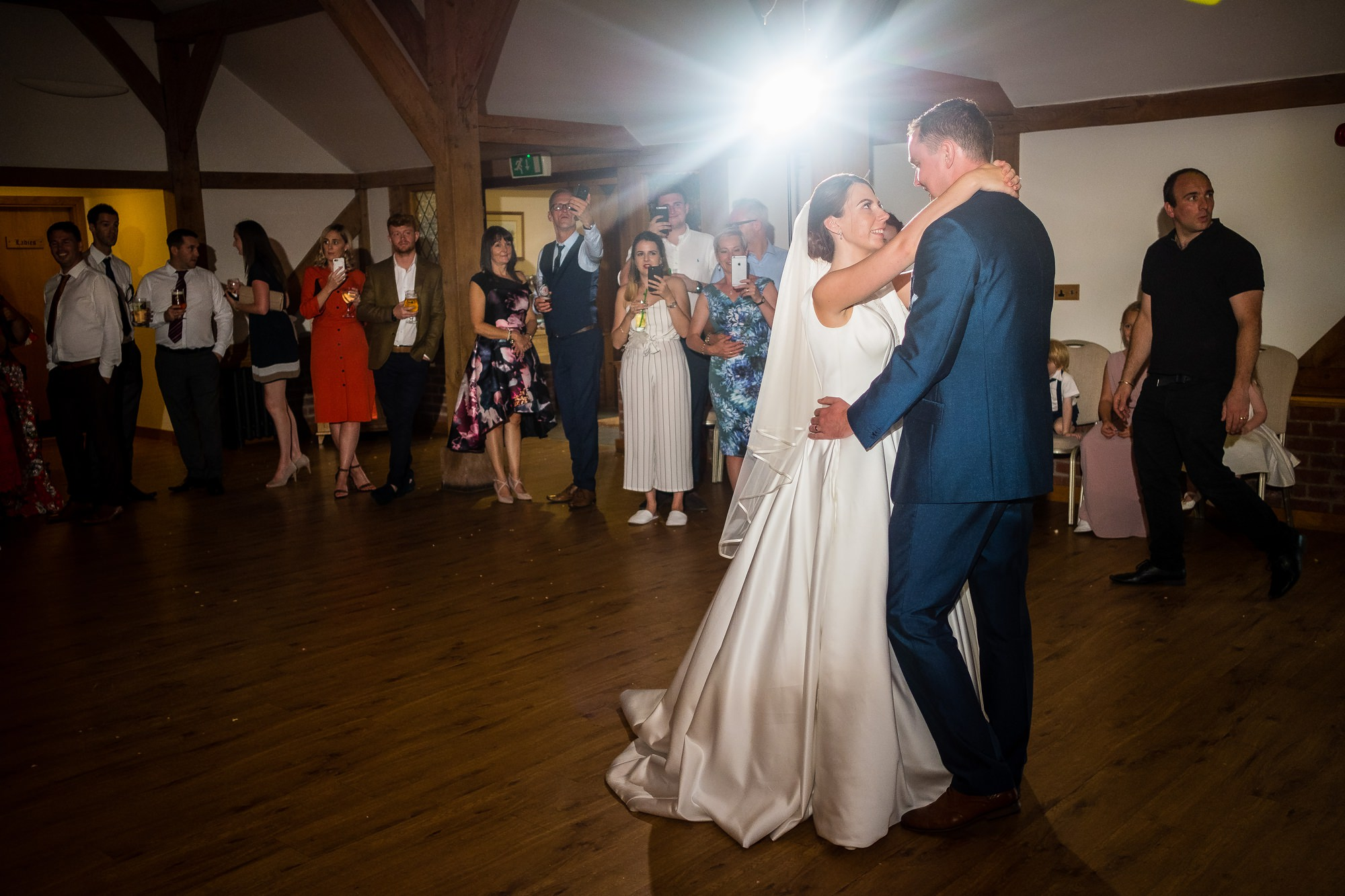 bride and groom doing their first dance at sandhole oak barn