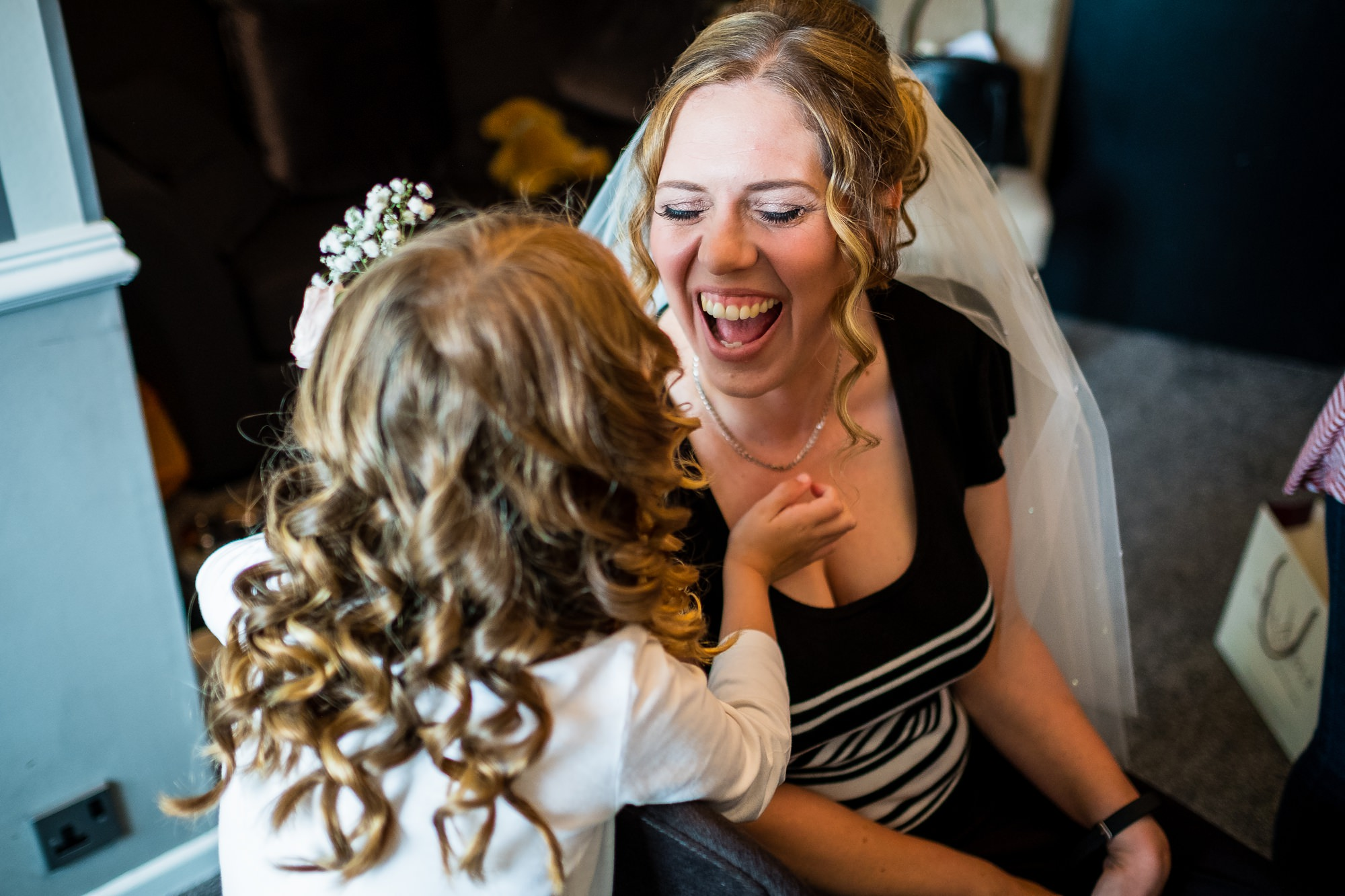 bride laughing with daughter