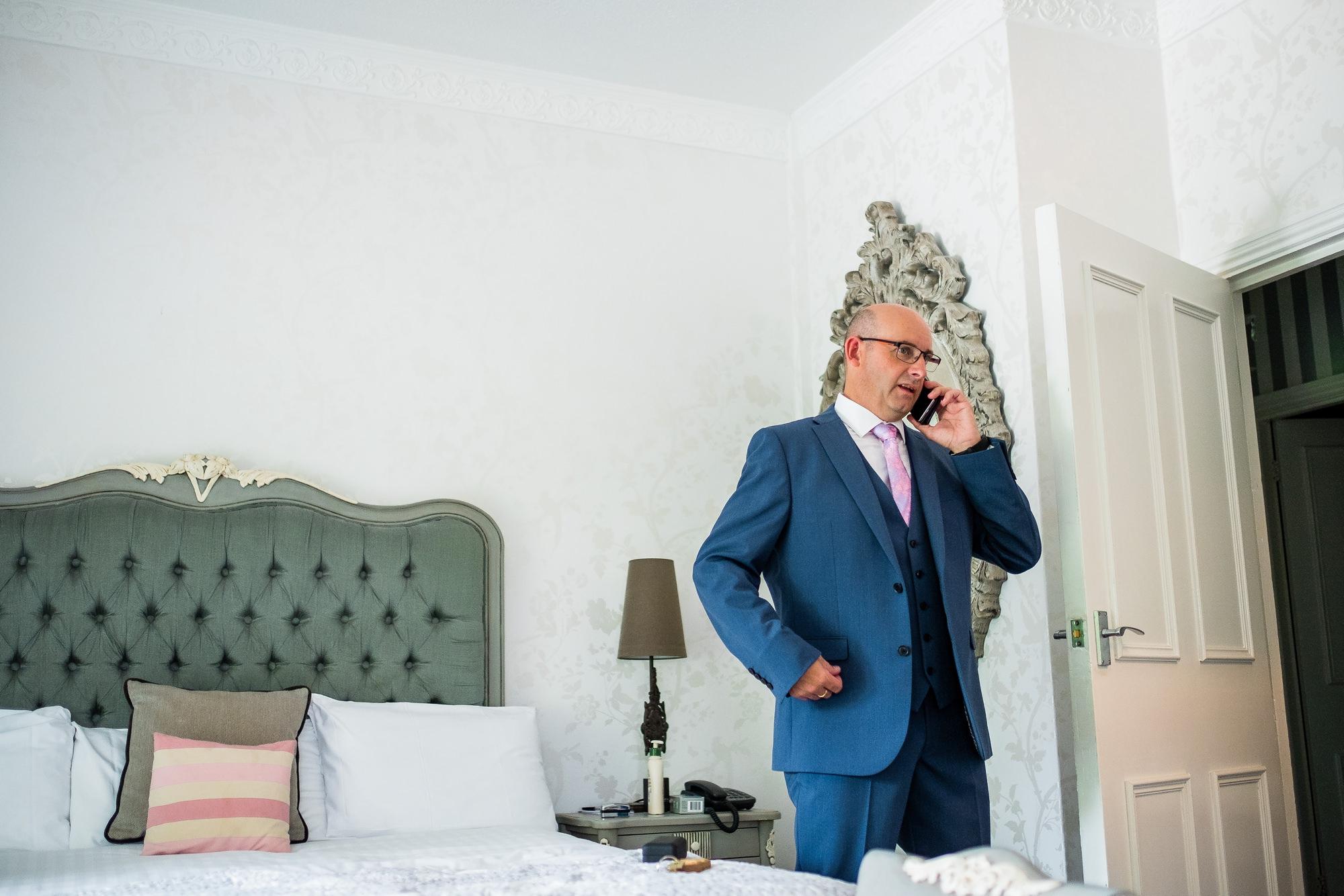 groom making final phone call