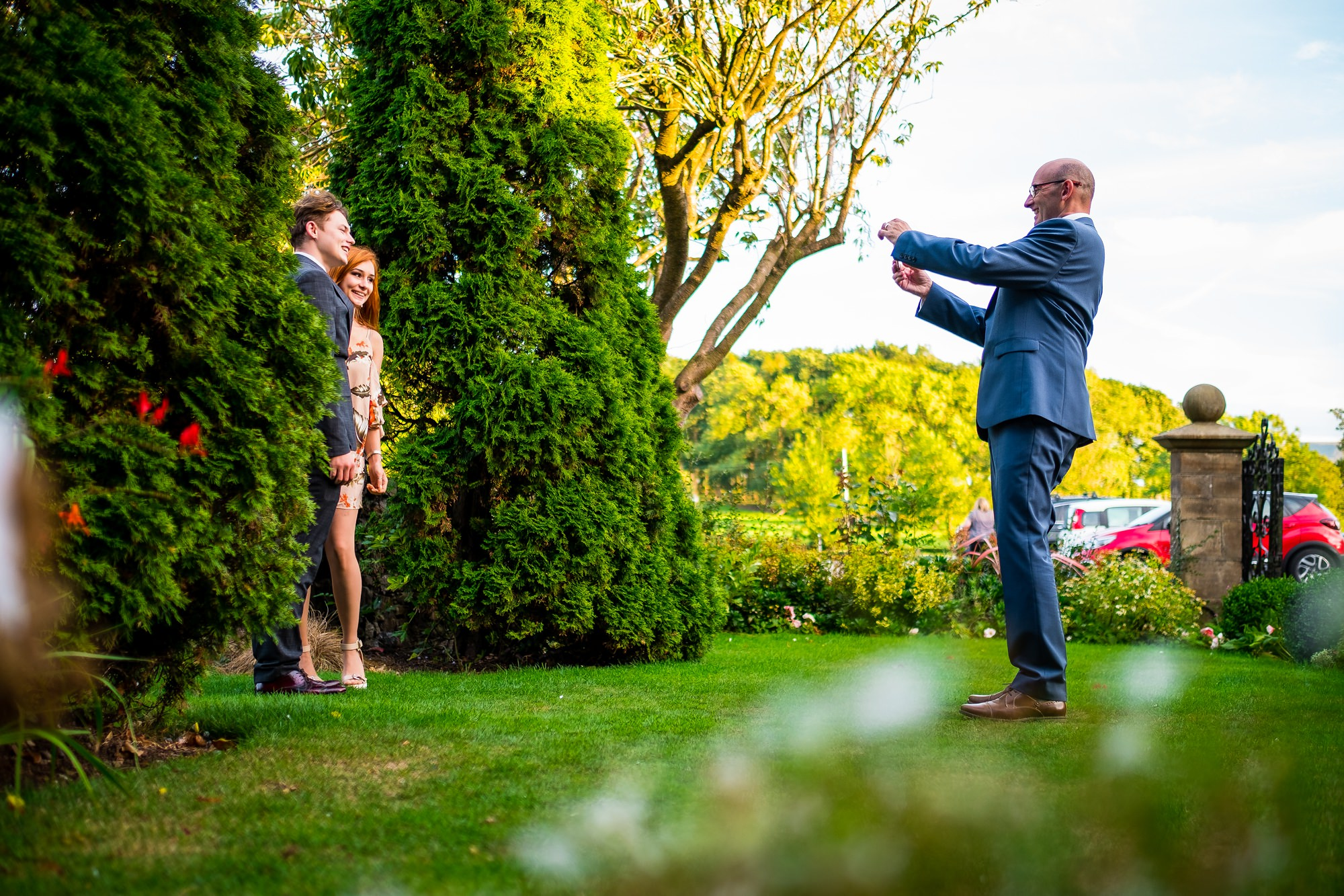 groom taking photo of guests