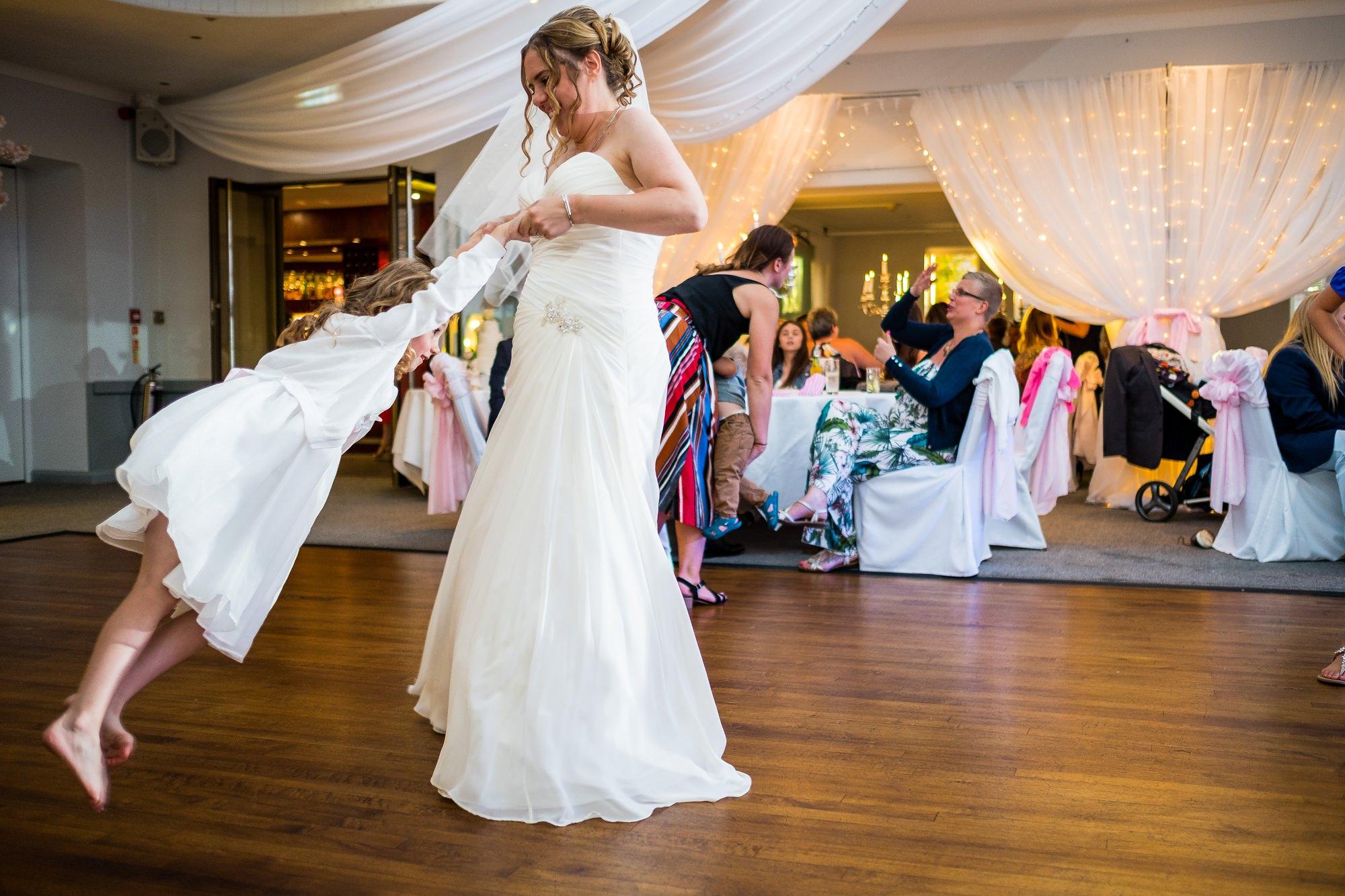bride spinning flower girl