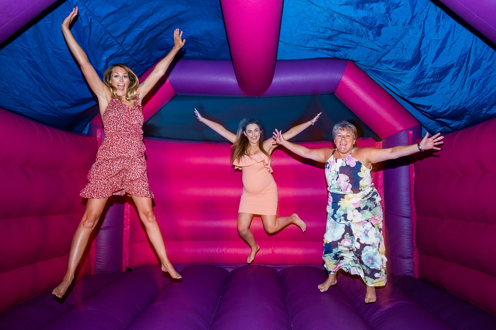 guests on bouncy castle at night