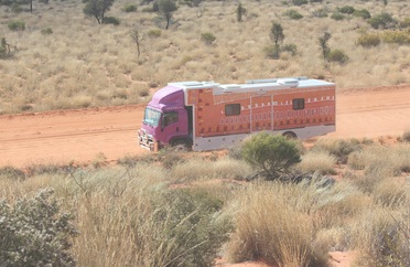 THE PURPLE TRUCK OUT ON THE ROAD