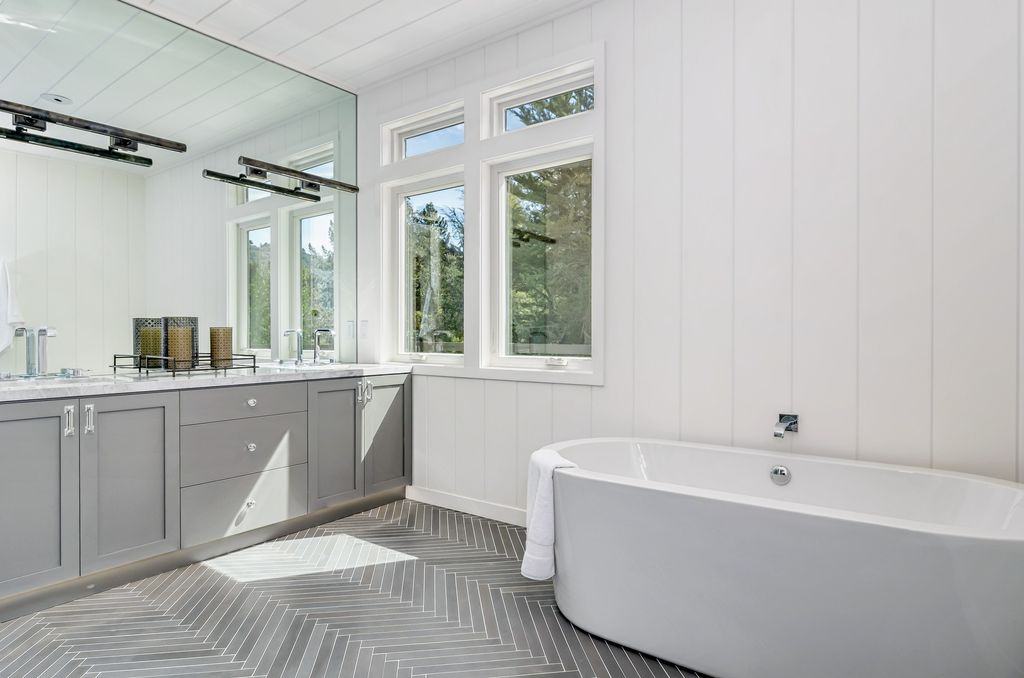 transitional-master-bathroom-with-freestanding-tub-herringbone-tile-and-wainscoting-i_g-ISd8radmlxqr7a0000000000-wY2w3.jpg