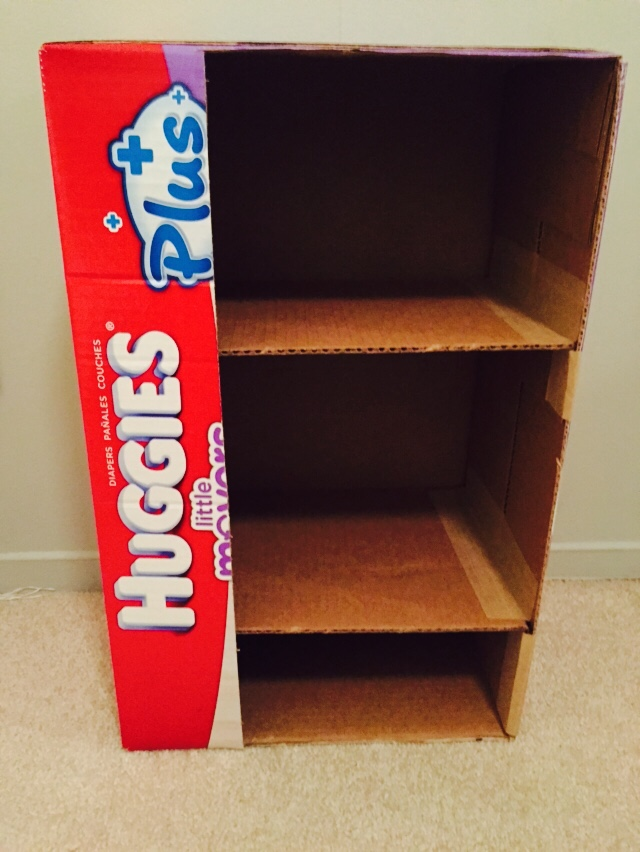 4. Cut opening for cabinets. Use your glue gun to glue in shelves. Use the paper tape to further reinforce the shelves on both sides and top and bottom. This will keep them secure.