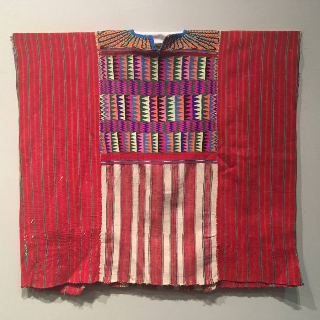 Ceremonial huipil, made of cotton. Mayan Traje at the San Jose Museum of Quilts and Textiles surveys the changing language of traditional dress from the early 20th century to modern day.  (Rachael Myrow/KQED)