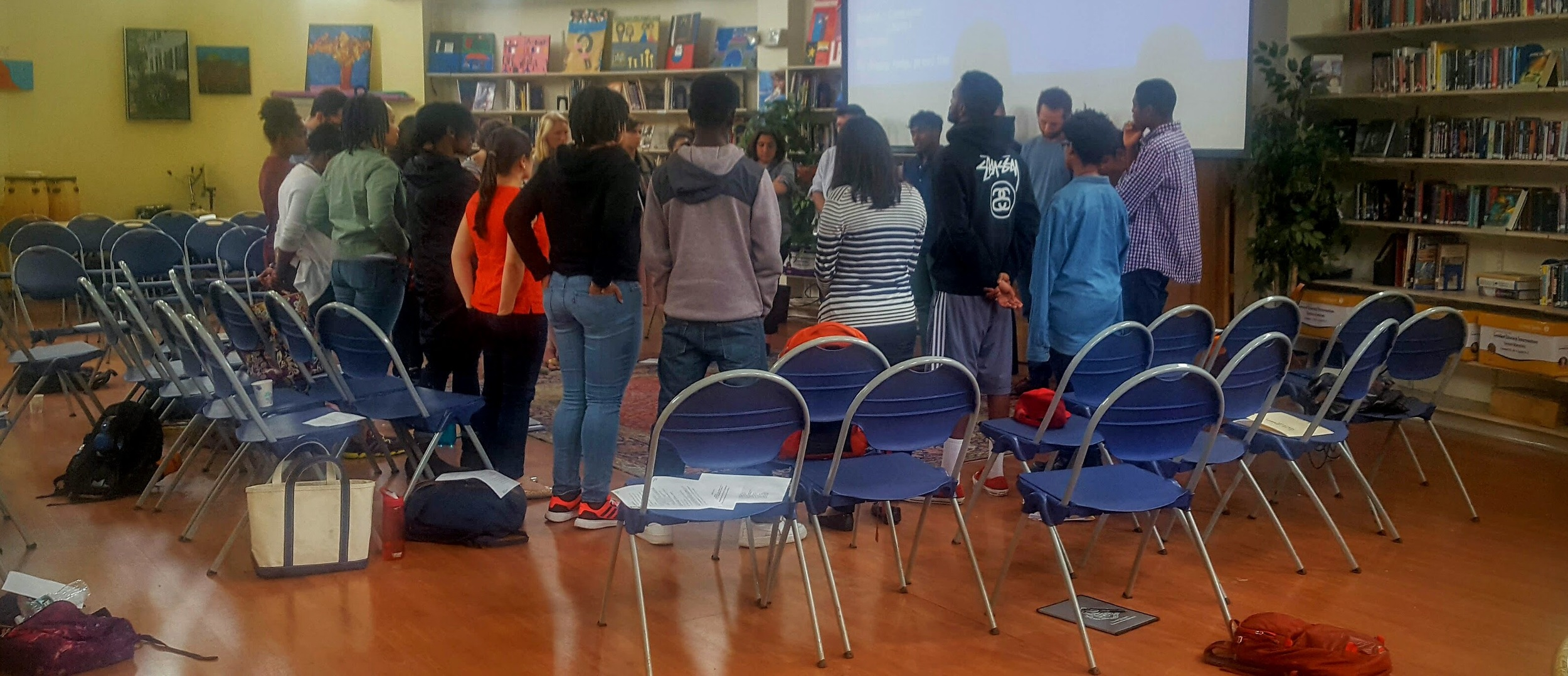 Teaching specialists during a mindfulness activity reflecting on recent events during workshop.