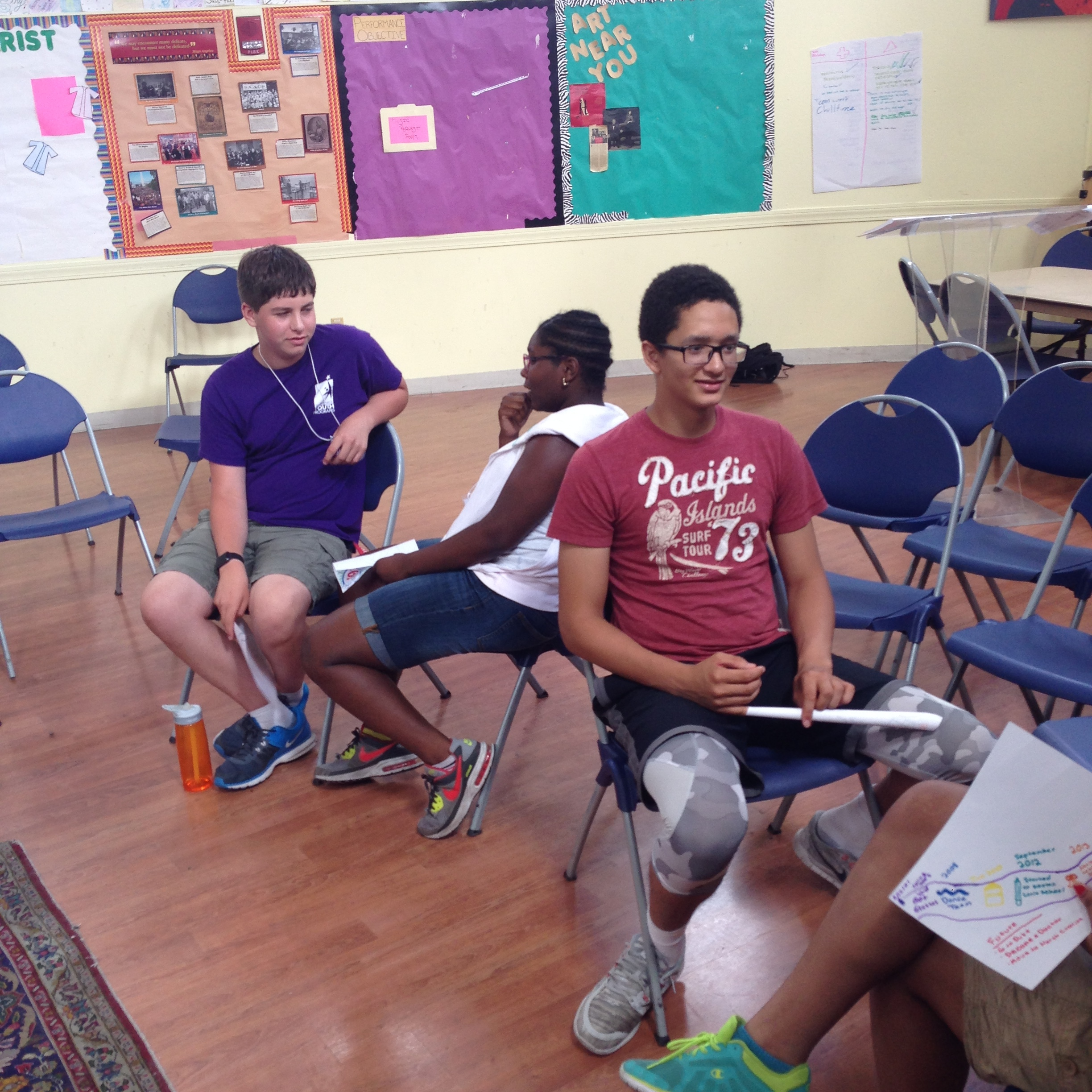 Students engage in interview practice.