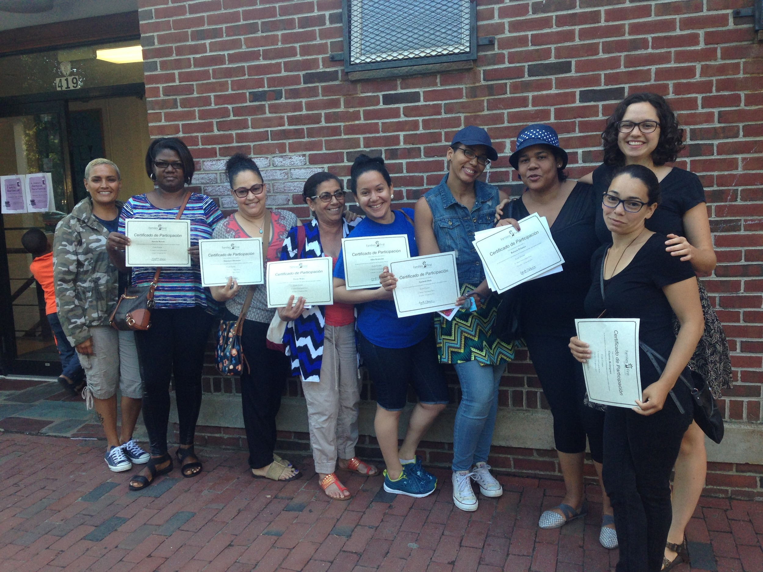 Parents receive certificates after completing a series of workshops in partnership with Families First.