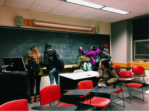 Professors for the day! JCITs check out a Tufts University classroom and learn that class sizes are small, with an average of 20-25 students per class depending on your major.