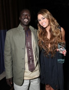 Okello Sam with Global Action Youth Leadership Award Winner Miley Cyrus at the 2011 Global Action Awards