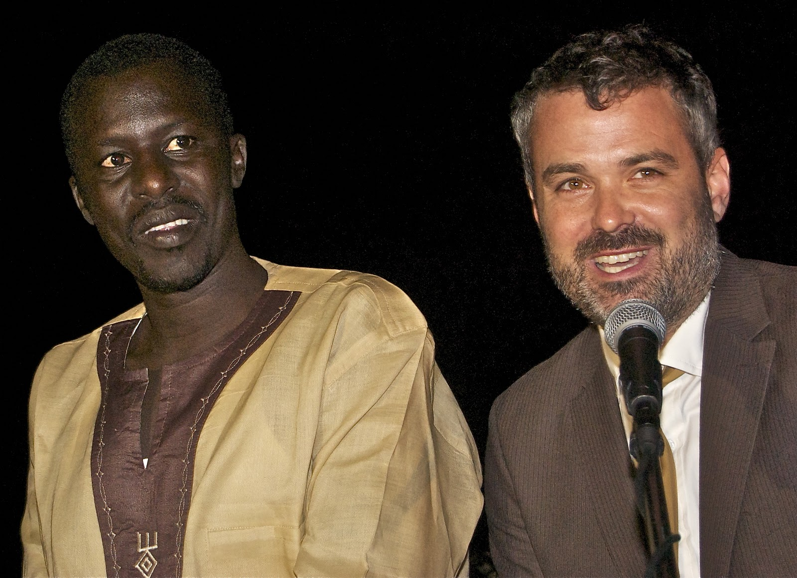 Okello Sam and Chris Talbott introducing Hope North at the Evening of Hope and Happiness (Allan Peach)